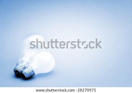 Background with lit lightbulb. Isolated on blue #28270975
