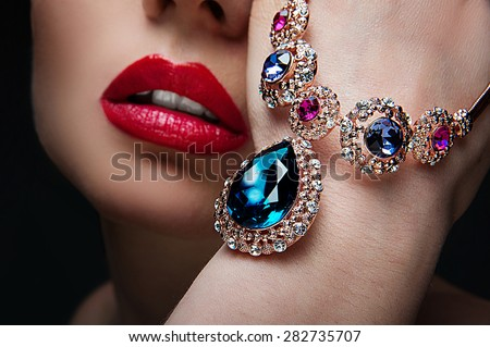 beautiful woman with jewelry, close-up Royalty-Free Stock Photo #282735707