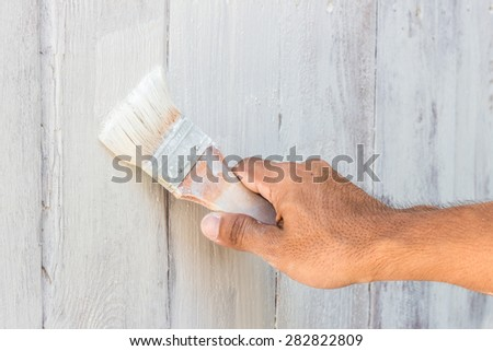 man decorating or painting with a paint brush #282822809