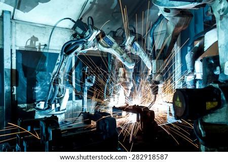 Welding robots movement in a car factory #282918587