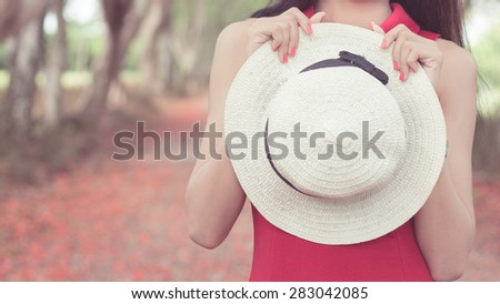 white hat with red dress #283042085
