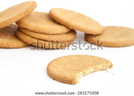 BISCUITS - Delicious wheat round biscuits with a few crumbs isolated on white #283275008