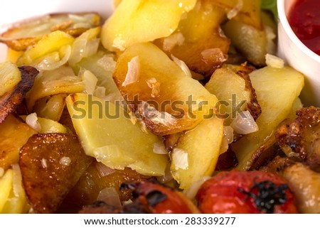 Delicious roasted potatoes with minced onion and fresh dill. Macro. Can be used as a whole background. #283339277