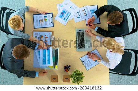 Business people sitting and discussing at business meeting, in office #283418132