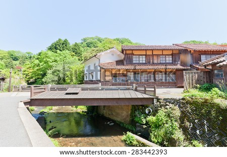 OMORI, JAPAN - MAY 19, 2015:  Old traditional houses and wooden bridge in Omori town of Iwami Ginzan Silver Mine cultural landscape, Shimane Prefecture, Japan. World Heritage site of UNESCO #283442393