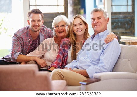 Family With Adult Children Relaxing On Sofa At Home Together #283528382