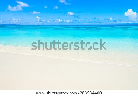 Tropical wave sea on the beach on blue sky background #283534400