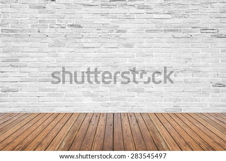 Old interior room with broken white brick wall and grunge wood floor texture #283545497