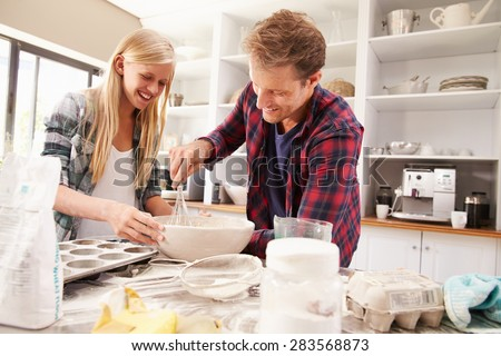 Father and daughter making a cake together #283568873