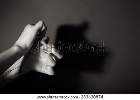 Hands gesture like man face on gray background #283630874