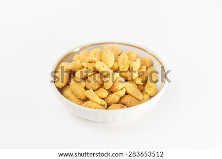 Bowl salted peanuts isolated on a white background #283653512