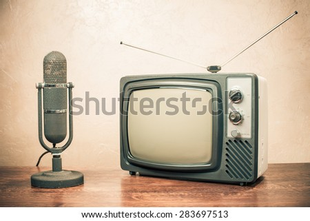 Retro television and old microphone from 50s. Vintage instagram style filtered photo