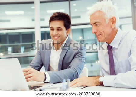 Two businessmen in fornt of computer in office #283750880