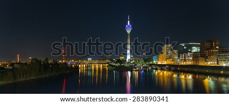 Dusseldorf with view on media harbor at night panorama  #283890341