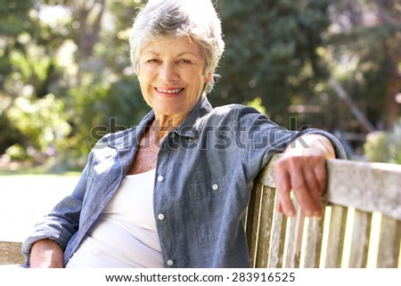 Senior Woman Relaxing On Park Bench #283916525