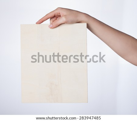 hand holding blank paper isolated on white background #283947485