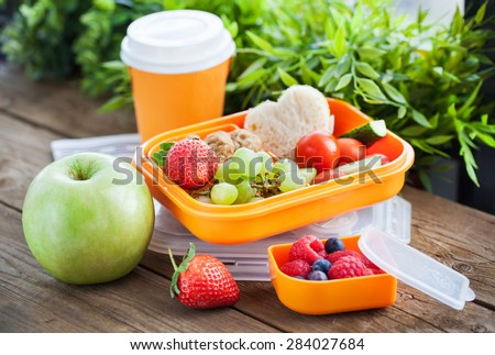 Lunch box for kids with sandwich, cookies, fresh veggies and fruits #284027684