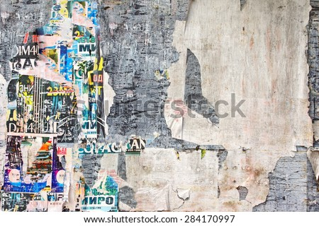 Old Billboard with Torn Posters. Vintage Background and Texture for text or image Royalty-Free Stock Photo #284170997