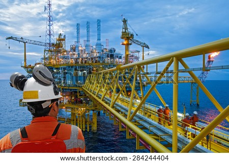 worker and offshore rig background.  Royalty-Free Stock Photo #284244404