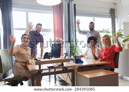 business, startup and office concept - happy creative team waving hands in office #284395085