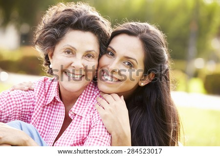 Mother With Adult Daughter In Park Together Royalty-Free Stock Photo #284523017