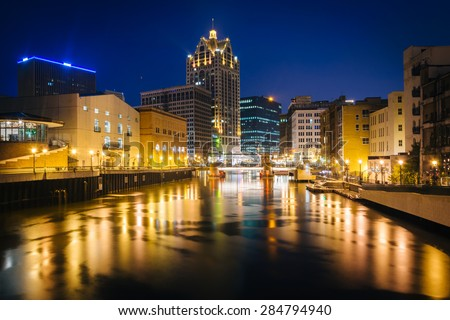 Buildings along the Milwaukee River at night, in Milwaukee, Wisconsin.
