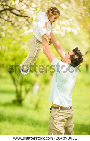 Young father playing with little pretty daughter  in summer park. #284890031