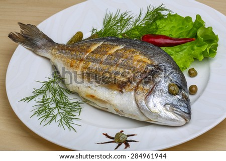 Grilled dorado with salad leaves and dill #284961944