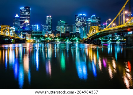 The Pittsburgh skyline reflecting in the Allegheny River at night, seen from the North Shore, in Pittsburgh, Pennsylvania.