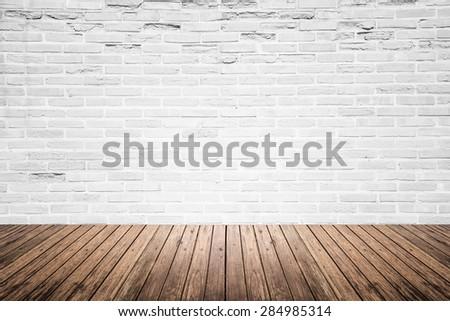 Old interior room with broken white brick wall and grunge wood floor texture #284985314