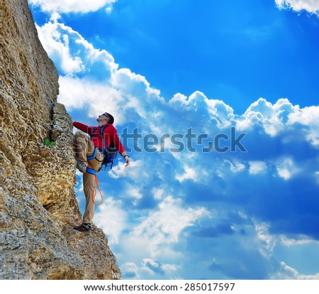Young man climbing on rock, and blue sky #285017597