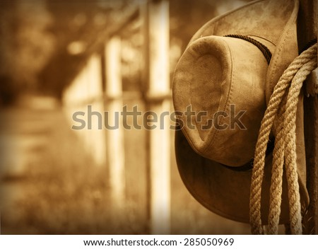 Western background with cowboy hat and lasso