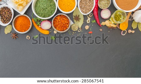 Group of indian spices and herbs difference ware on stone background with top view and copy space for design foods, vegetable, spices, herbs or other your content. #285067541