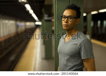 Young African Asian man in New York City in subway station serious face #285140066