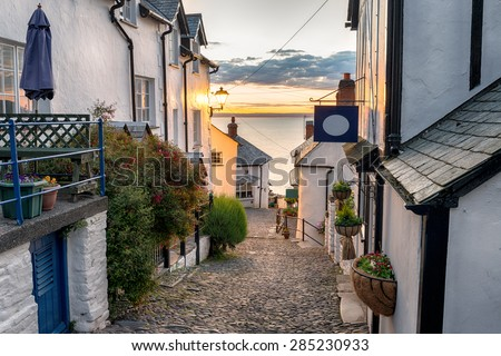 Narrow cobbled streets lined with cottages on a steep hill at Clovelly on the Devon coast Royalty-Free Stock Photo #285230933