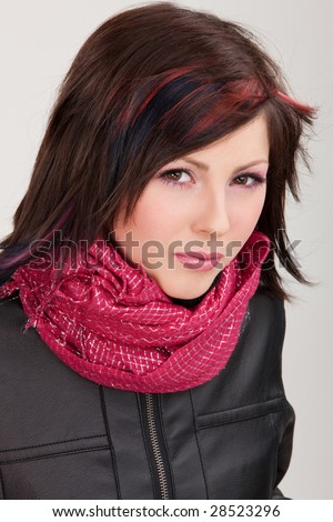 Brunette girl in leather jacket on isolated white #28523296