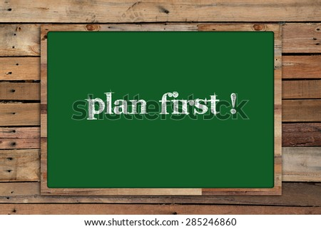 'plan first!' write on Green board on wood background #285246860