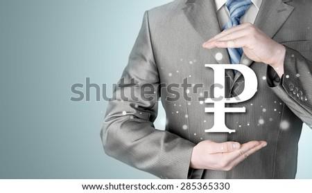 businessman protecting ruble symbol #285365330