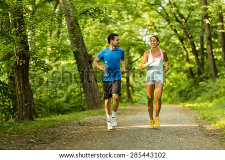 Young people jogging and exercising in nature #285443102