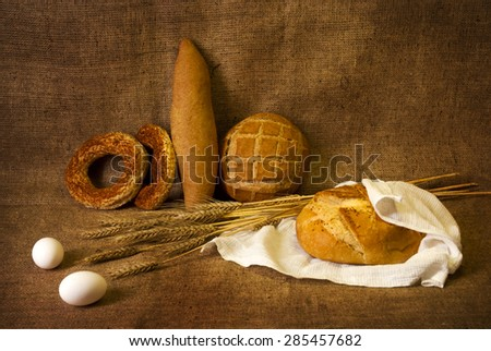 Still Life with ears of wheat and bread #285457682