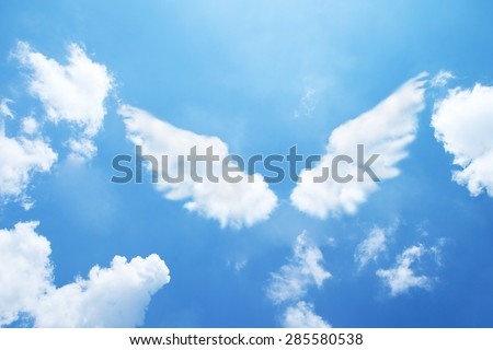 Angel wings formed from clouds. Royalty-Free Stock Photo #285580538