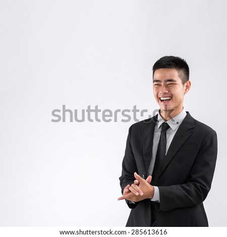 Cheerful businessman in suit applauding to business partners to greet them #285613616