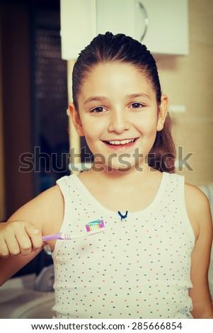 Happy Little girl brushing teeth in bath #285666854