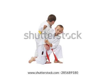 Two athletes in kimono fighting on a white background #285689180