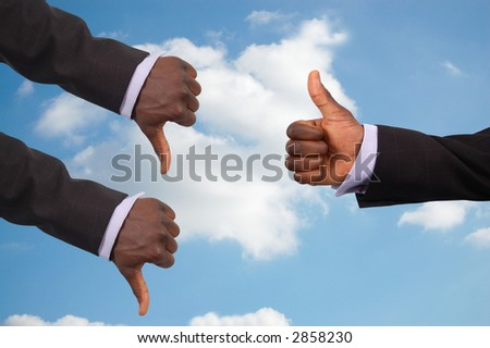 """This is an image some hands competing against each other with a sky in the background.This image can be used to represent the theme """"Team Decisions"""" #2858230"""