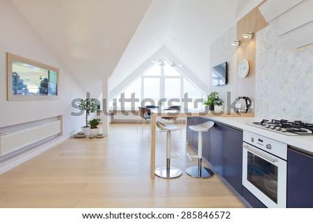 modern interior light a large apartment in mansard #285846572