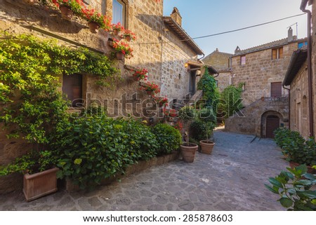Stairs with colorful flowers in a Tuscan old town #285878603
