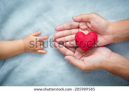 baby and mothers hands made symbol of love. #285989585