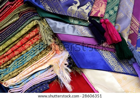 Colorful cloth with oriental patterns at Floating Market in Thailand #28606351