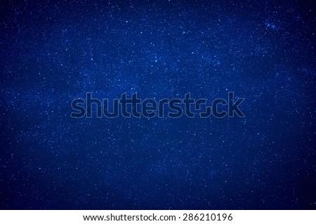 Blue dark night sky with many stars. Milky way like space background